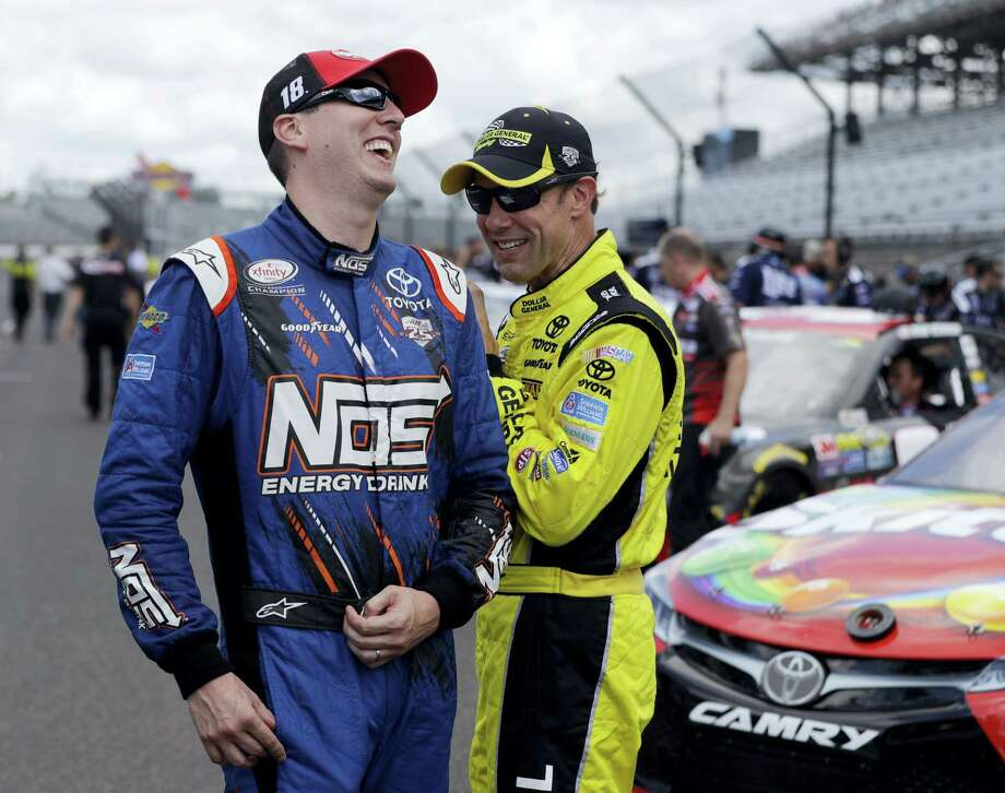 Sprint Cup Series driver Kyle Busch (18) laughs with driver Matt Kenseth (20) before qualifications for the Brickyard 400 NASCAR auto race at Indianapolis Motor Speedway in Indianapolis, Saturday. Photo: Darron Cummings — The Associated Press   / Copyright 2016 The Associated Press. All rights reserved. This material may not be published, broadcast, rewritten or redistribu