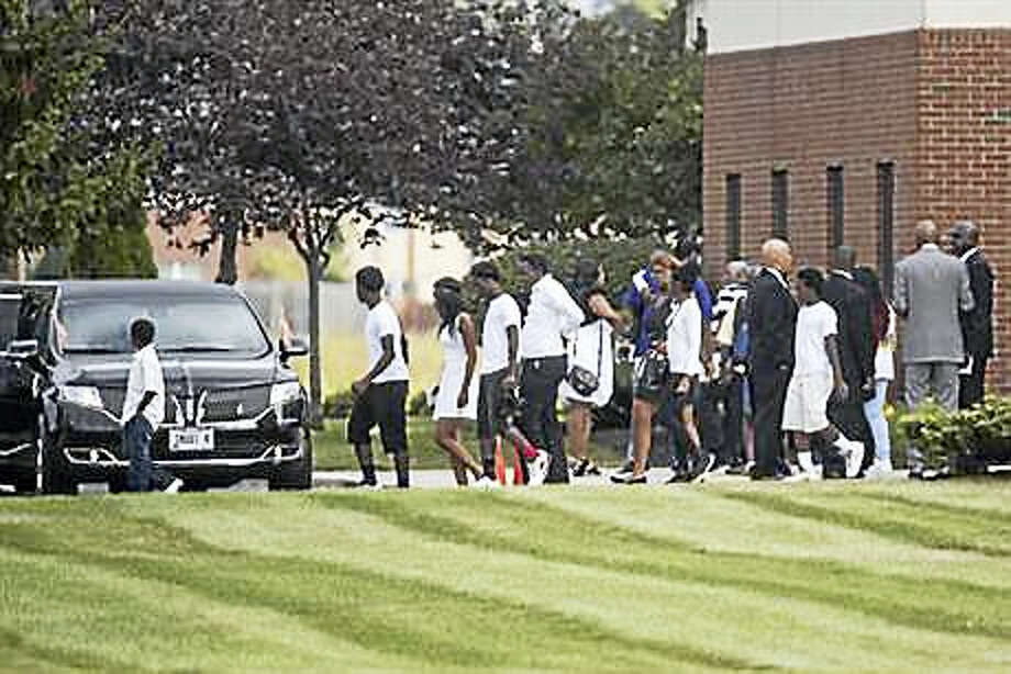 Mourners exit funeral services for Tyre King, the 13-year-old Ohio boy who was fatally shot by Columbus police, Saturday, Sept. 24, 2016, at the First Church of God in Columbus, Ohio. Police say Officer Bryan Mason shot Tyre on Sept. 14 after the boy ran from investigators and pulled out a BB gun that looked like a real firearm. Photo: AP Photo/John Minchillo