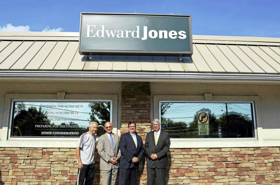 Edward Jones opens branch office in West Haven: From left, Vincent N. Amendola Sr., city Corporation Counsel Vincent N. Amendola Jr. and Mayor Edward M. O'Brien join Edward Jones financial adviser Darryl T. Zebrowski on Sept. 14 at the grand opening of the financial services firm's West Haven office at 5 Wagner Place, Suite 4. The new office, between Main Street and Sawmill Road, is housed in a remodeled plaza with the law office of the younger Amendola, who owns the property. For more than 90 years, Edward Jones has developed tailored financial goals and strategies for nearly 7 million clients, including those preparing for retirement, living in retirement, paying for education and preparing for the unexpected. The Fortune 500 company, headquartered in St. Louis, has more than 12,700 branch office locations in the U.S. and Canada. Photo: CONTRIBUTED PHOTO — MICHAEL P. WALSH