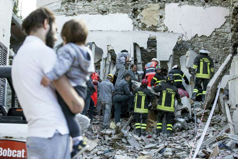 Firefighters search amid rubble following an earthquake in Accumoli, central Italy, Wednesday, Aug. 24, 2016. A strong earthquake in central Italy reduced three towns to rubble as people slept early Wednesday, with reports that as many as 50 people were killed and hundreds injured as rescue crews raced to dig out survivors. Photo: Angelo Carconi/ANSA Via AP    / ANSA