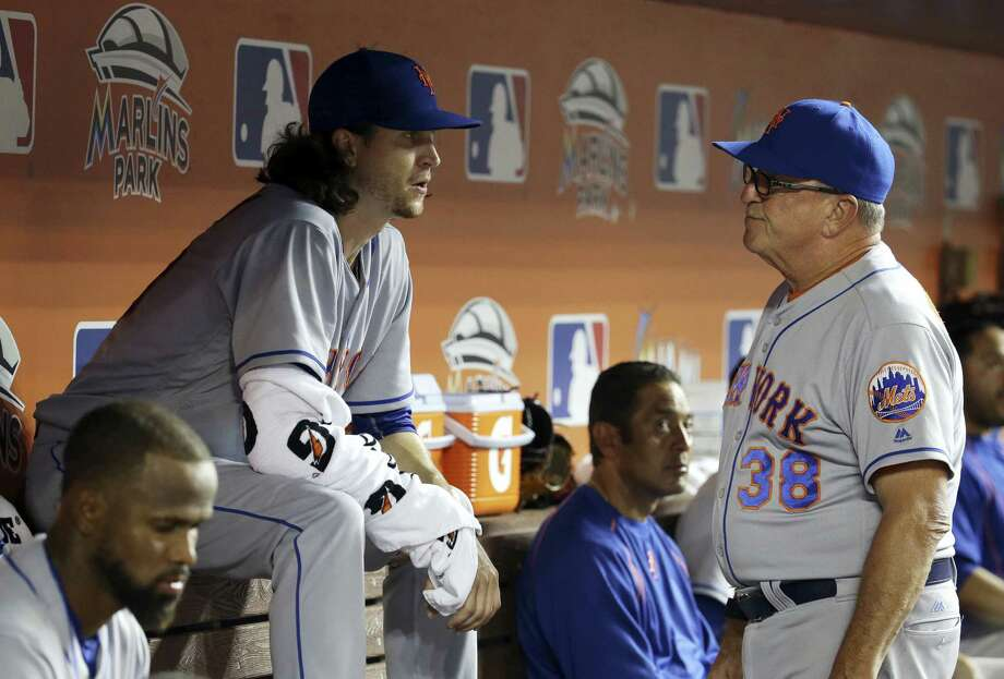 Mets starting pitcher Jacob deGrom, left, talks with pitching coach Dan Warthen during the fourth inning on Saturday. Photo: Lynne Sladky — The Associated Press   / Copyright 2016 The Associated Press. All rights reserved. This material may not be published, broadcast, rewritten or redistribu