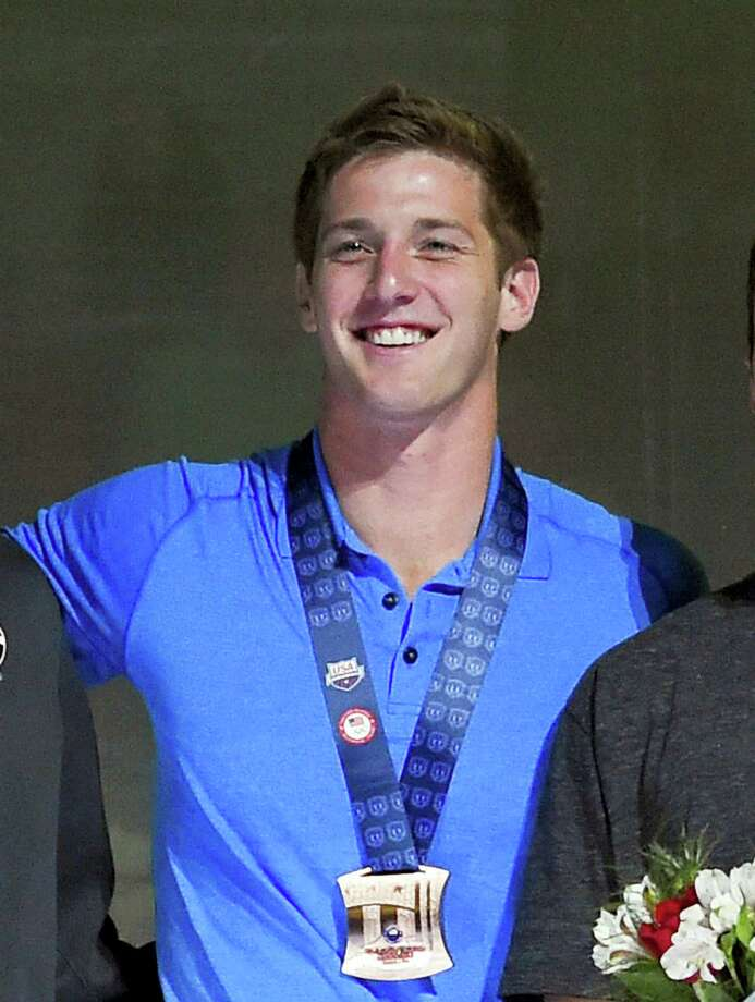 "In this July 3, 2016, file photo, U.S. swimmer Jimmy Feigen smiles during the men's 400-meter relay team medal ceremony at the U.S. Olympic swimming trials, in Omaha, Neb. Feigen apologized for the ""serious distraction"" he and three teammates caused at a gas station during the Rio Olympics, saying he omitted facts in his statement to police. Feigen says in a statement posted Tuesday, Aug. 23, 2016, on the website of his lawyer in Austin, Texas, that ""I omitted the facts that we urinated behind the building and that Ryan Lochte pulled a poster off the wall."" Photo: AP Photo/Mark J. Terrill, File    / Copyright 2016 The Associated Press. All rights reserved. This material may not be published, broadcast, rewritten or redistribu"