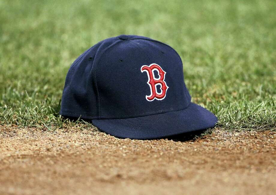 Boston Red Sox's Hanley Ramirez's hat lies on the field after he lost it while attempting to field a ball during the sixth inning of a baseball game against the Minnesota Twins in Boston, Saturday, July 23, 2016. (AP Photo/Michael Dwyer) Photo: AP / AP