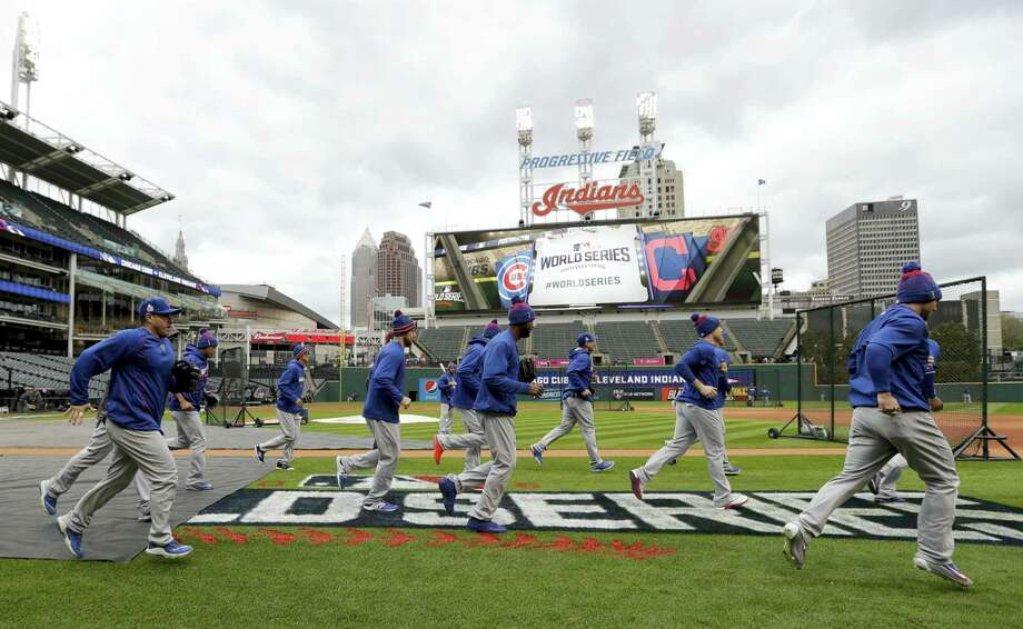 Members of the Chicago Cubs warm up during a practice for the World Series Monday in Cleveland. Photo: David J. Phillip — The Associated Press   / AP