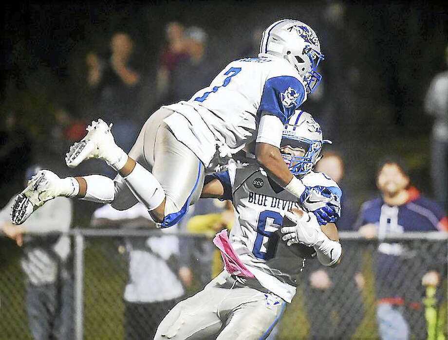 West Haven's Kyle Godfrey (7) celebrated with his brother Anthony Godfrey (6) after Anthony's 78 yard run for a touchdown in the third quarter Friday night as their team defeated Notre Dame (WH), 36-13, at Veterans Memorial Field in West Haven. Photo: Catherine Avalone — New Haven Register   / New Haven RegisterThe Middletown Press