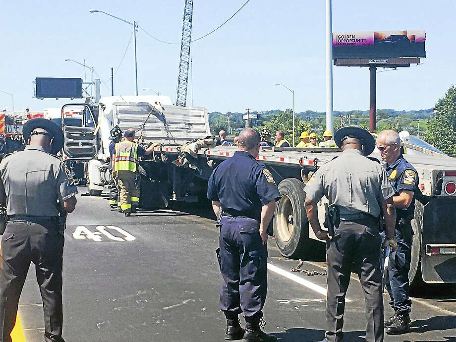 Interstate 95 south was shut down late Wednesday morning between Exits 44 and 43 after a tractor-trailer crash. One person had to be extricated from the wreckage before being taken to the hospital. Photo: Courtesy Of Connecticut State Police