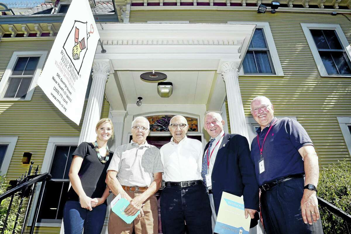 From left, Kelsey Nawaf, development manager at Ronald McDonald House; Johnny Ragozzino, chairman of the St. Patrick's Church Neighborhood Reunion; Anthony Mastriano, adviser for the St. Patrick's Church Neighborhood Reunion; Richard Popilowski, director of the capital campaign, Ronald McDonald House Charities of Connecticut & Western Massachusetts; and Stocky Clark, executive director, Ronald McDonald House Charities of Connecticut & Western Massachusetts, are photographed in front of the Ronald McDonald House in New Haven.