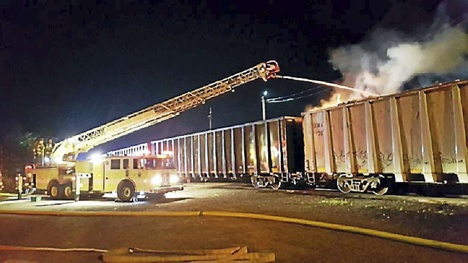 The North Haven Fire Department extinguishes an overnight rail car fire at the CSX Cedar Hill Yard. Photo: Contributed Photo
