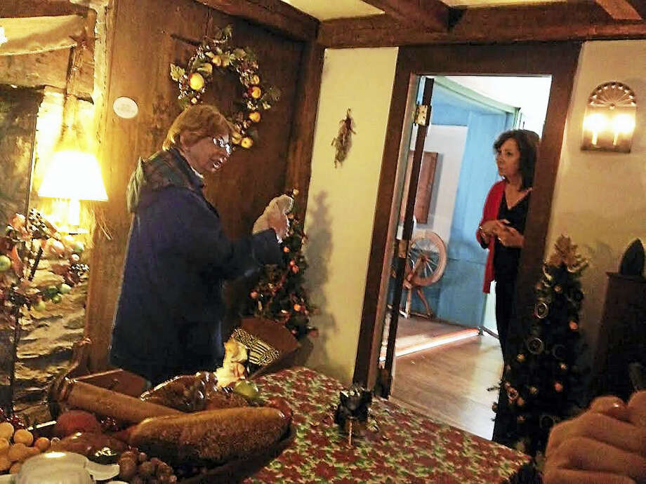 Retired West Haven Head Librarian Connie Sacco, left, talks about the history of the Ward-Heitmann House Thursday while museum board Vice President Patrice Farquharson and others listen. Photo: Mark Zaretsky — New Haven Register