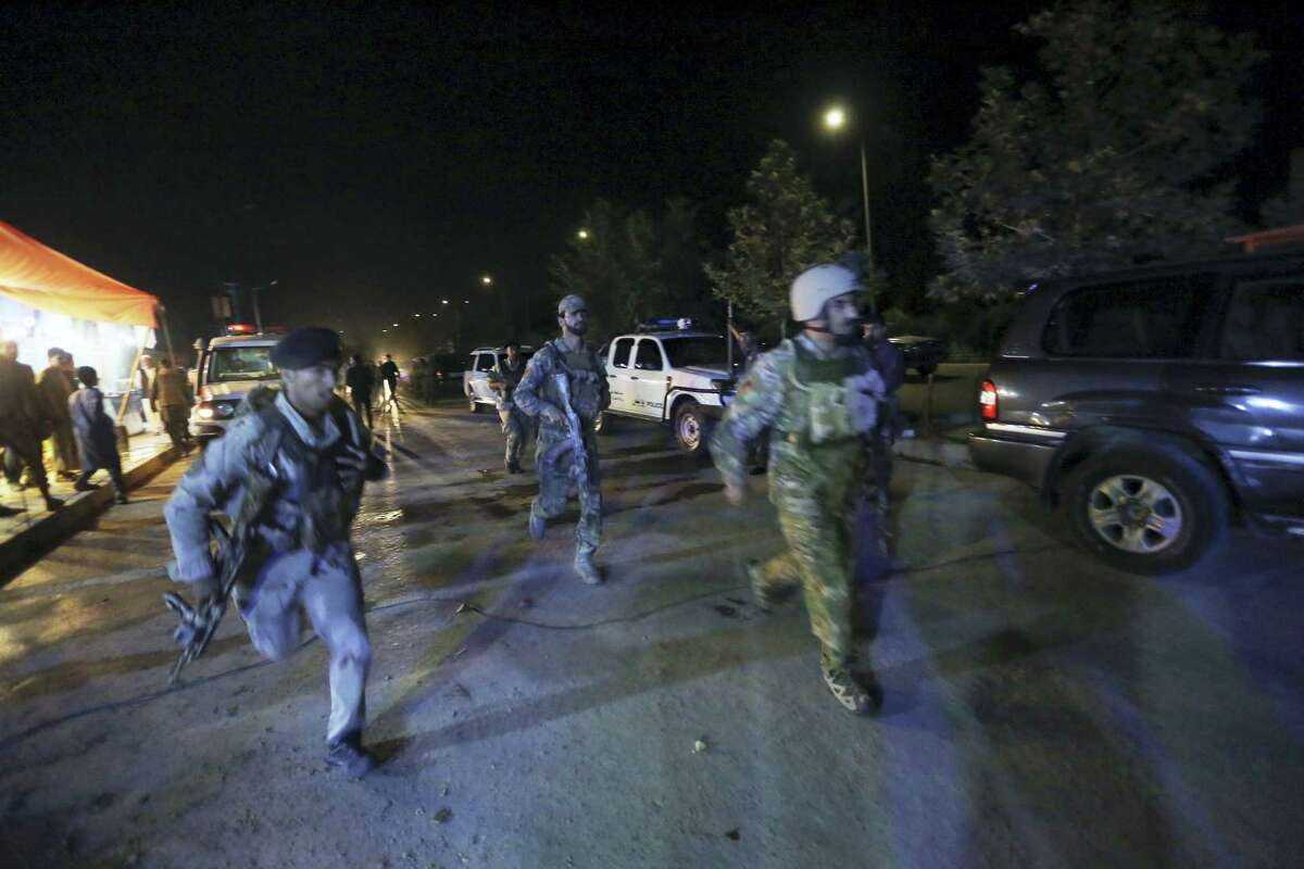 """Afghan security forces rush to respond to a complex Taliban attack on the campus of the American University in the Afghan capital Kabul on Wednesday, Aug. 24, 2016. """"We are trying to assess the situation,"""" President Mark English told The Associated Press."""