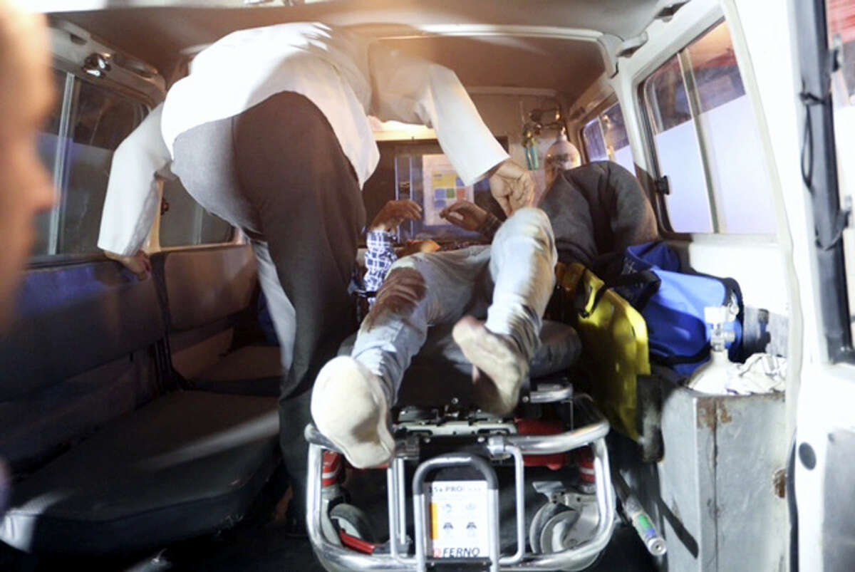 """AP Photo/Rahmat Gul A wounded person is treated in an ambulance after a complex Taliban attack on the campus of the American University in the Afghan capital Kabul on Wednesday, Aug. 24, 2016. """"We are trying to assess the situation,"""" President Mark English told The Associated Press."""