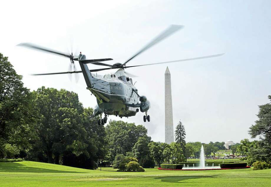 Marine One, seen here, with President Barack Obama and first lady Michelle Obama aboard, lifting off from the South Lawn of the White House in Washington in July. Photo: The Associated Press   / Copyright 2016 The Associated Press. All rights reserved. This material may not be published, broadcast, rewritten or redistribu