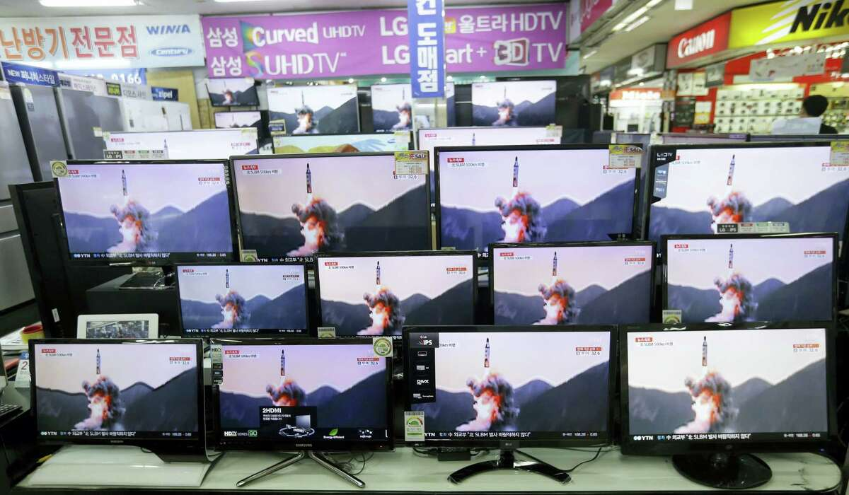 TV screens show file footage of a similar North Korea's ballistic missile that North Korea claimed to have launched from underwater at the Yongsan Electronic store in Seoul, South Korea, Wednesday, Aug. 24, 2016. A North Korean ballistic missile fired from a submarine Wednesday flew about 500 kilometers (310 miles) in the longest flight by that type of weapon, Seoul officials said, a range that can place much of South Korea within its striking distance.