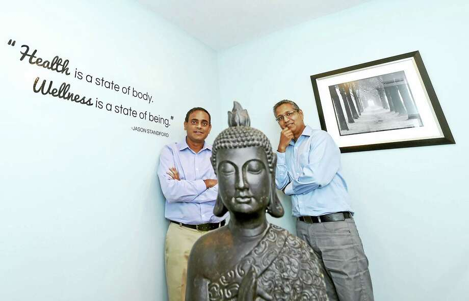 Tejal Desai, left, and Raj Patel, co-owners of the Southern CT Wellness & Healing, a medical marijuana dispensary, in their new Milford office on Tuesday. Photo: Peter Hvizdak — New Haven Register   / ?2016 Peter Hvizdak