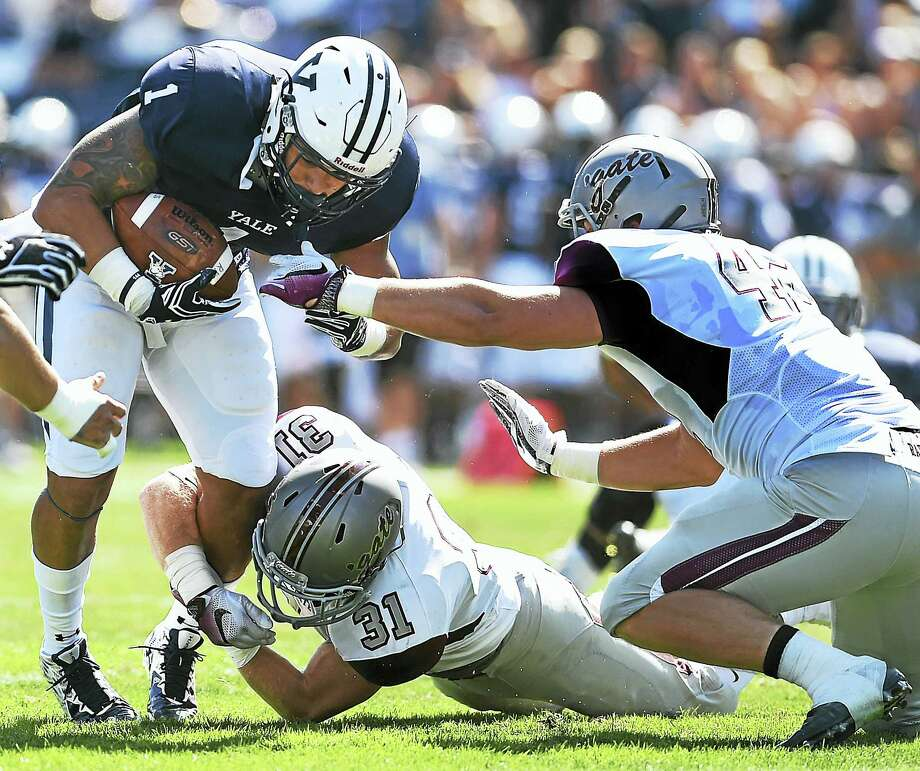 Colgate's Christian Hardegree (31) tackles Yale's Dale Harris during last week's game. Photo: Catherine Avalone — Register File Photo   / New Haven RegisterThe Middletown Press