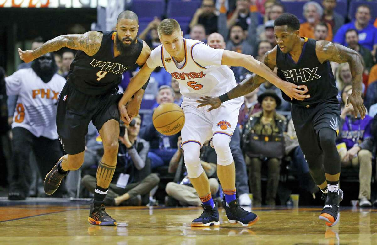 Phoenix Suns center Tyson Chandler (4) and guard Eric Bledsoe (2) chase a loose ball with New York Knicks forward Kristaps Porzingis (6) in the first half of an NBA basketball game Tuesday, Dec. 13, 2016 in Phoenix.