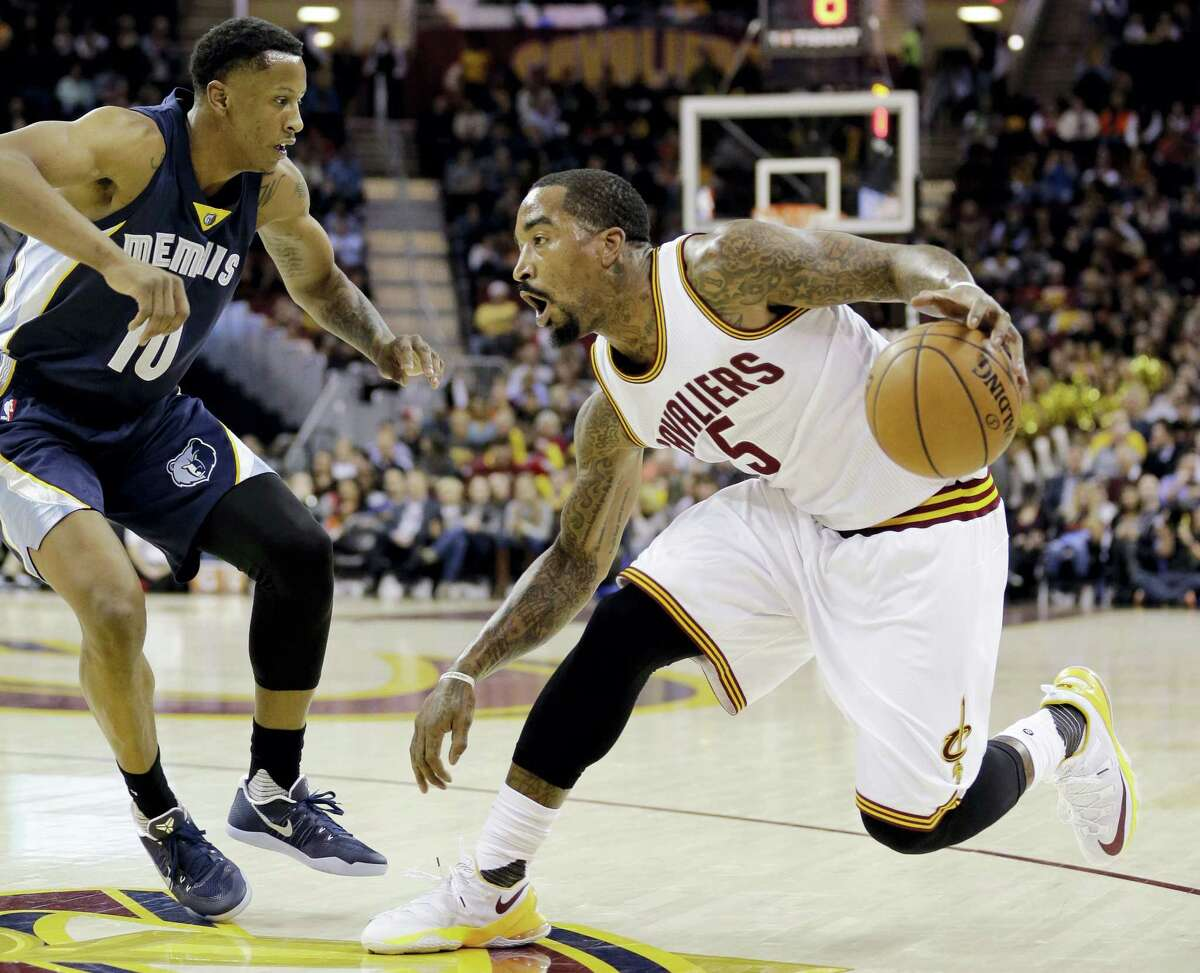 Cleveland Cavaliers' J.R. Smith (5) drives past Memphis Grizzlies' Troy Williams (10) in the first half of an NBA basketball game Tuesday, Dec. 13, 2016 in Cleveland.