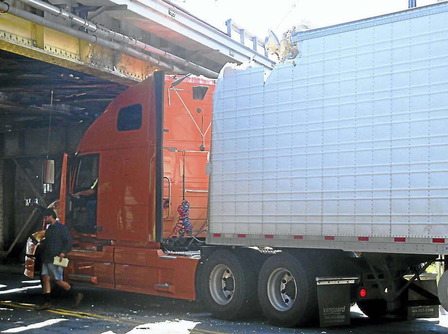 Part of James Street was shut down for more than an hour Wednesday after a tractor-trailer crashed into a rail bridge. No one was hurt in the accident, which briefly suspended rail service. Photo: Wes Duplantier — The New Haven Register