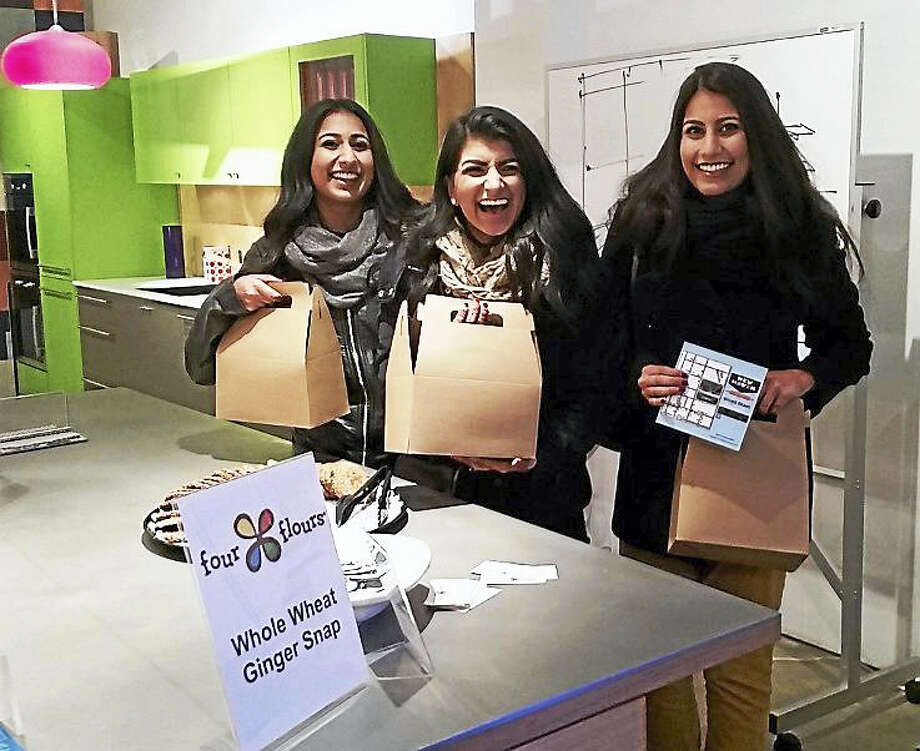 Sisters Huma, Noor, and Huda Khalid from Orange came to join the fun after participating in last year's Wine On9 event. The New Haven Cookie Crawl was part of the Town Green District's First Fridays events that give everyone a reason to celebrate the community and local small businesses every month. Photo: Jason C. Diaz — New Haven Register