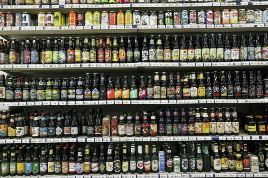 In this file photo, a shelf is stocked high with hundreds of varieties of single beers at Liquor Mart in Boulder, Colo. The Beer Institute says it is encouraging its members to start displaying more product information on labels, packaging and websites in a push to provide consumers with more details about ingredients, calories and other nutritional facts about their beverages. Photo: Brennan Linsley — The Associated Press File   / Copyright 2016 The Associated Press. All rights reserved. This material may not be published, broadcast, rewritten or redistribu