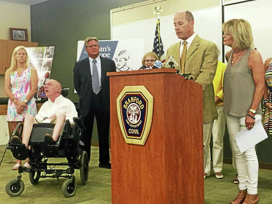 Dr. Jack Kelley and his wife, Jean, speak at a news conference Wednesday about statewide screening for adrenoleukodystrophy in newborns. Photo: Sam Norton — New Haven Register