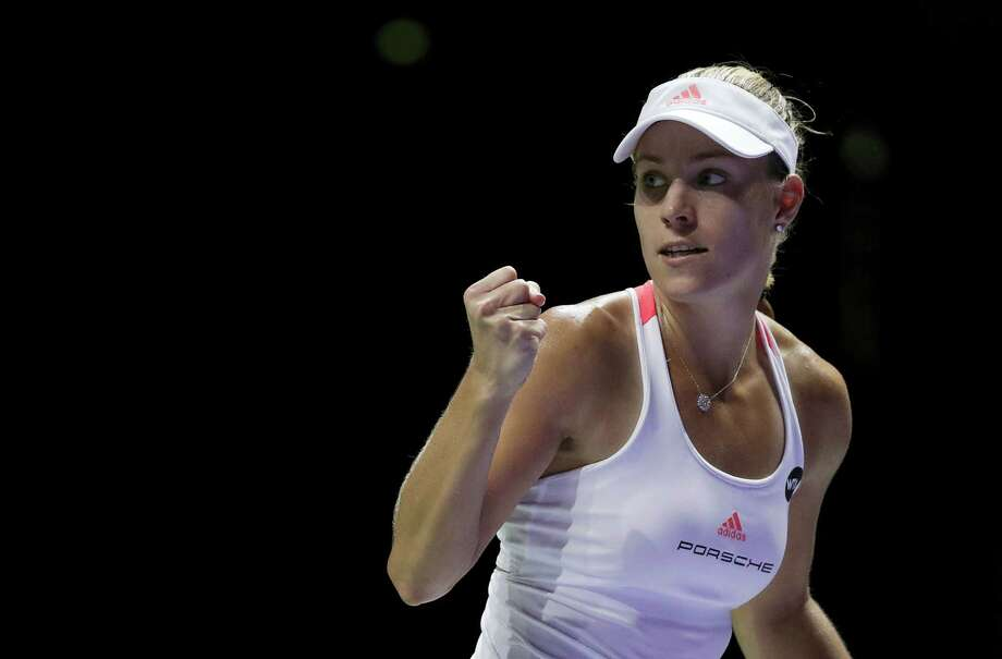Angelique Kerber of Germany celebrates after beating Dominika Cibulkova of Slovakia during their singles match at the WTA tennis tournament in Singapore on Oct. 23, 2016. Photo: AP Photo/Wong Maye-E   / Copyright 2016 The Associated Press. All rights reserved.