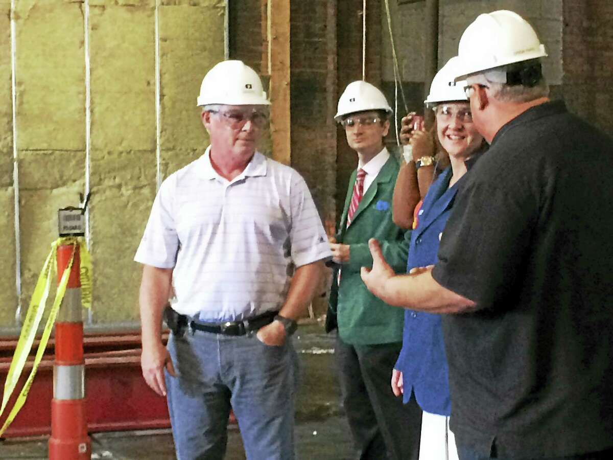 U.S. Rep. Elizabeth Esty listens as Consolidated Industries General Manager Drew Papio, right, discusses the company's renovations to its Mixville Road plant. Looking on is the company's President and CEO John Wilbur, left.