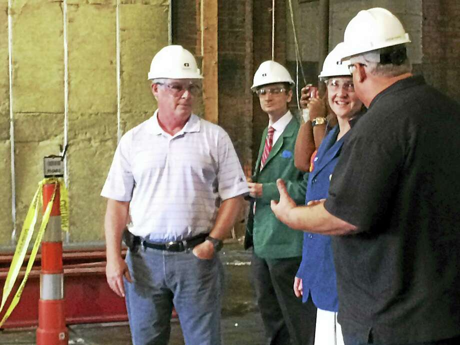 U.S. Rep. Elizabeth Esty listens as Consolidated Industries General Manager Drew Papio, right, discusses the company's renovations to its Mixville Road plant. Looking on is the company's President and CEO John Wilbur, left. Photo: LUTHER TURMELLE — NEW HAVEN REGISTER