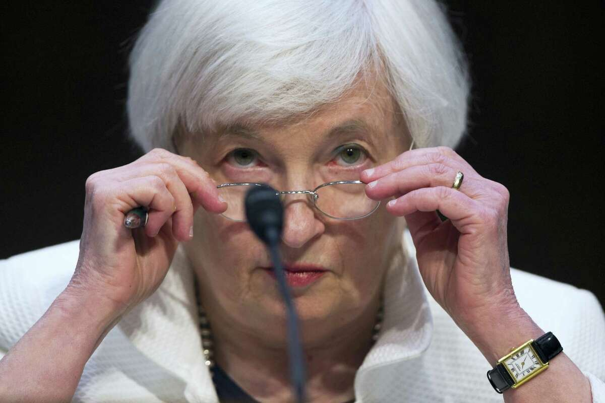 Federal Reserve Chairman Janet Yellen adjusts her glasses as she testifies on Capitol Hill in Washington, D.C., in June.