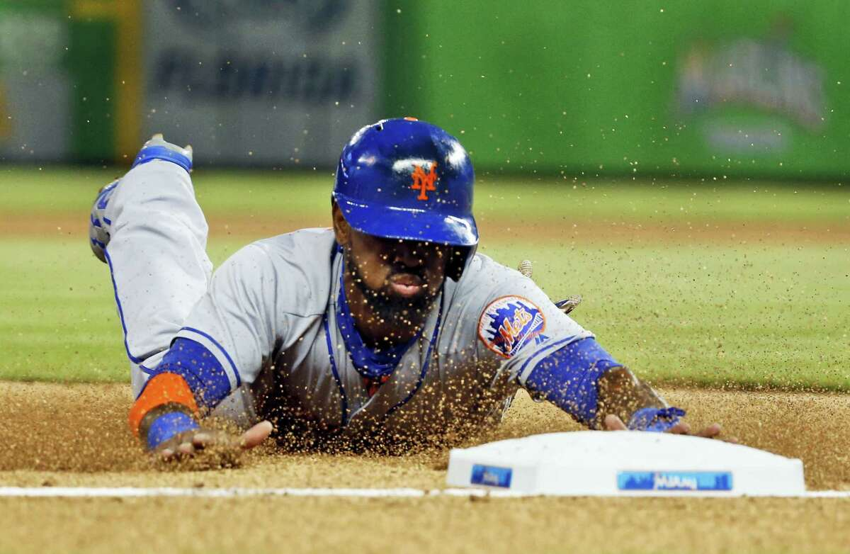 Jose Reyes slides as he steals third base during the first inning against the Marlins on Friday.