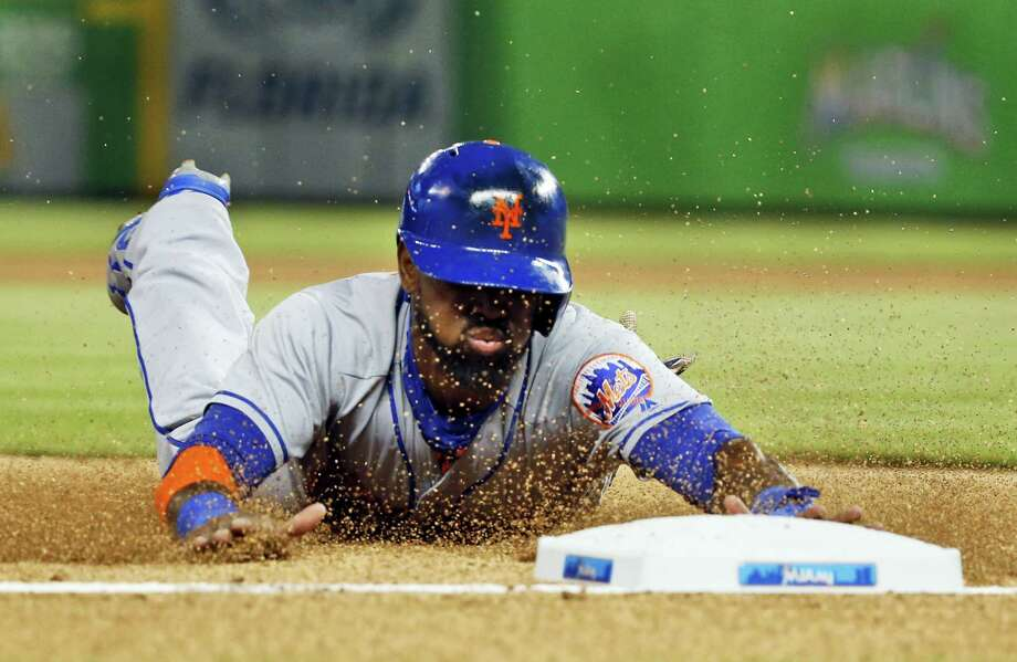 Jose Reyes slides as he steals third base during the first inning against the Marlins on Friday. Photo: Wilfredo Lee — The Associated Press   / Copyright 2016 The Associated Press. All rights reserved. This material may not be published, broadcast, rewritten or redistribu