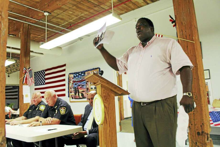Ansonia NAACP President Greg Johnson, right, speaks Wednesday night at a community conversation in Ansonia about policing and race relations. Photo: JEAN FALBO-SOSNOVICH — NEW HAVEN REGISTER