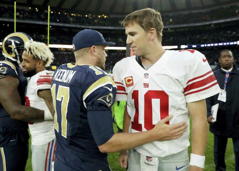 Giants quarterback Eli Manning, right, shakes hands with Rams quarterback Case Keenum after Sunday's game in London. Photo: Matt Dunham — The Associated Press   / AP