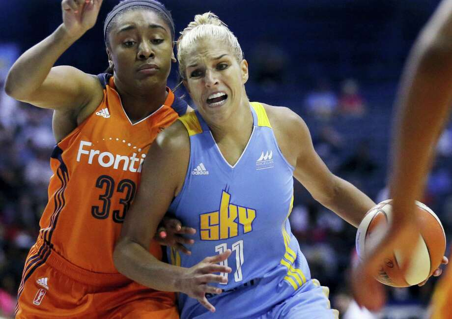 Chicago Sky forward Elena Delle Donne, right, drives as Connecticut Sun forward Morgan Tuck defends during the second half on Friday. Photo: Nam Y. Huh — The Associated Press   / Copyright 2016 The Associated Press. All rights reserved. This material may not be published, broadcast, rewritten or redistribu