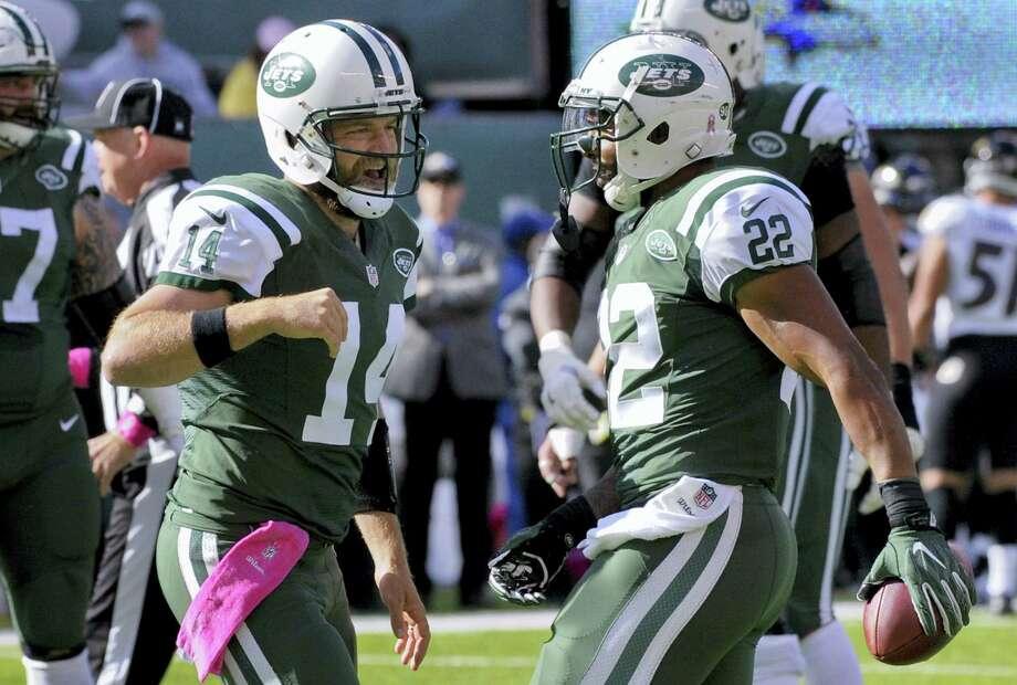 Jets quarterback Ryan Fitzpatrick, left, celebrates with running back Matt Forte after Forte scored a touchdown in the second quarter Sunday. Photo: Bill Kostroun — The Associated Press   / FR51951 AP