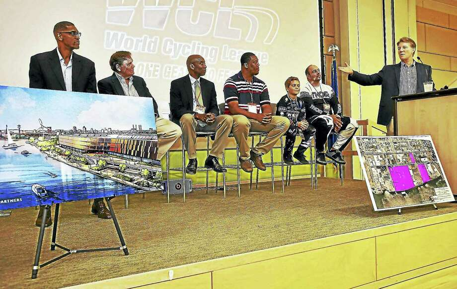 Yale graduate and lifelong cyclist Rick Mayer, right, one of the founders of The Everybody Plays Foundation, unveils the Centric Sports & Cycling Center to be built in Fair Haven. Photo: Catherine Avalone — New Haven Register