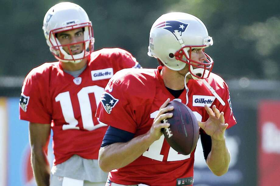 In this Aug. 9, 2016 photo, New England Patriots quarterback Tom Brady (12) gets set to throw a pass as quarterback Jimmy Garoppolo (10) watches during NFL football training camp in Foxborough, Mass. Photo: AP Photo/Elise Amendola, File   / Copyright 2016 The Associated Press. All rights reserved. This material may not be published, broadcast, rewritten or redistribu