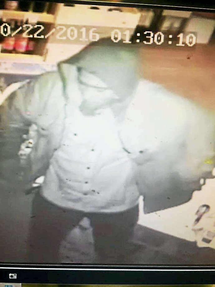 Seymour police are searching for a man who might have burglarized Crown Liquors Package Store on New Haven Road on Saturday, Oct. 22, 2016. Photo: Photo Courtesy Of Seymour Police Department