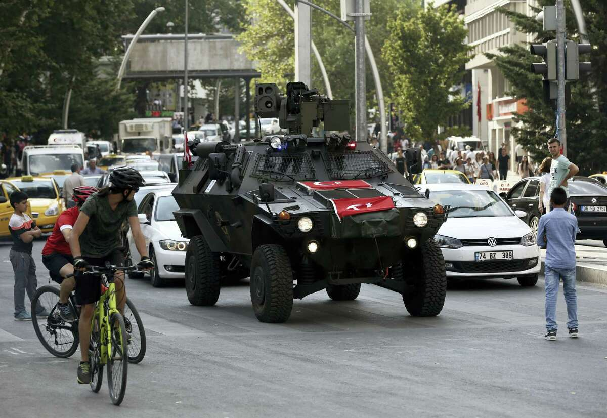 A police APC drives in the city center in Ankara, Turkey, Friday, July 22, 2016. Some Muslim faithful in Ankara welcomed Friday a declaration of a state of emergency by the top authorities, a move that gives President Recep Tayyip Erdogan sweeping powers in ruling the country.