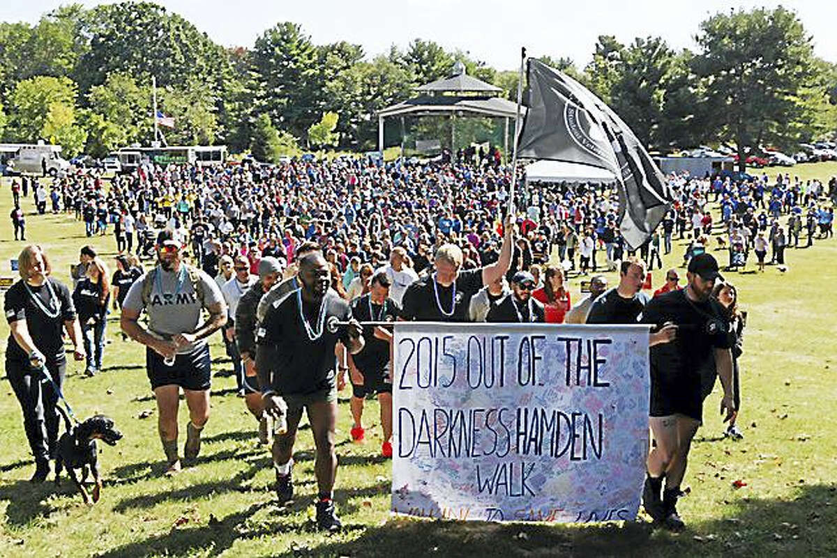Hundreds of walkers came out for last year's Out of the Darkness Walk at Hamden Town Center Park.