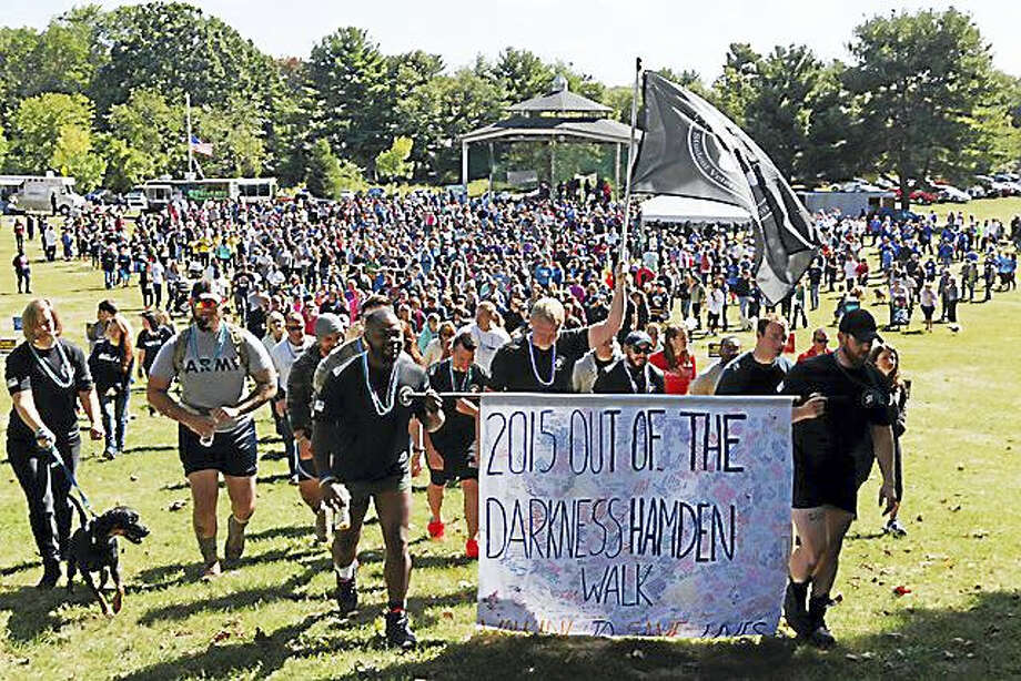 Hundreds of walkers came out for last year's Out of the Darkness Walk at Hamden Town Center Park. Photo: Contributed Photo