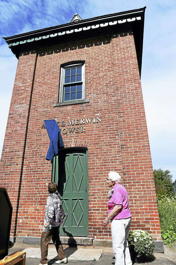 Lauralton Hall President Antoinette Iadarola, left, unveils the Alyce Merwin Tower during a dedication ceremony at the Milford school Friday. Merwin, right, graduated from Lauralton Hall in 1943. Photo: Arnold Gold — New Haven Register