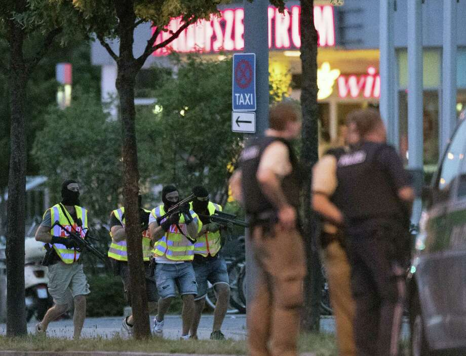 Special police forces prepare to search a neighbouring shopping centre outside the Olympia mall in Munich, southern Germany, Friday, July 22, 2016 after several people have been killed in a shooting. Photo: AP Photo — Sebastian Widmann / '