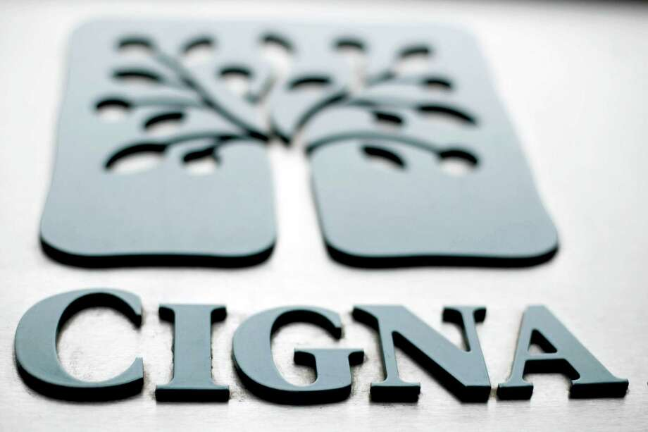 The Cigna logo is shown at the headquarters of the health insurer Cigna Corp., in Philadelphia. Anthem is buying rival Cigna, in a deal valued at $54.2 billion announced July 24, 2015 that will create the nation's largest health insurer by enrollment, covering about 53 million patients in the U.S. Photo: Matt Rourke — AP File Photo   / AP