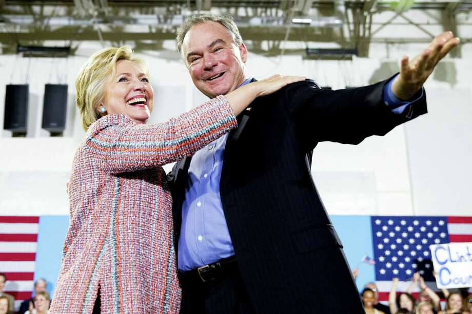 Democratic presidential candidate Hillary Clinton, accompanied by Sen. Tim Kaine, D-Va., speaks at a rally at Northern Virginia Community College in Annandale, Va. Clinton has chosen Kaine to be her running mate. Photo: AP Photo — Andrew Harnik / Copyright 2016 The Associated Press. All rights reserved. This material may not be published, broadcast, rewritten or redistribu