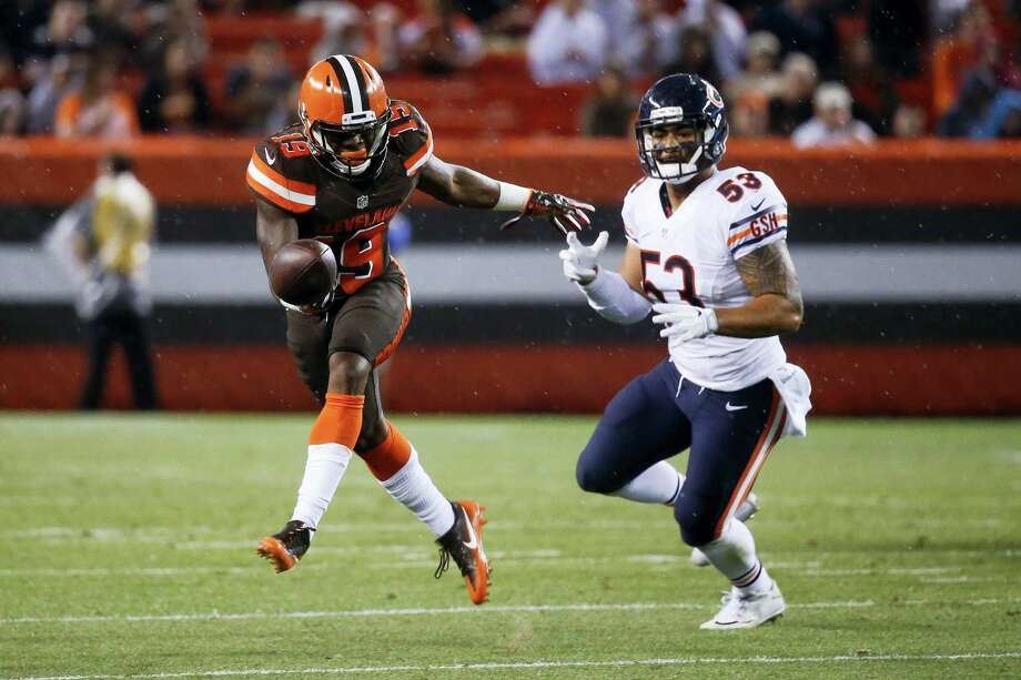 In this Sept. 1, 2016 photo, Cleveland Browns wide receiver Corey Coleman (19) can't catch a pass against Chicago Bears inside linebacker John Timu (53) in the first half of an NFL preseason football game in Cleveland. Coleman broke his hand during practice Sept. 21, 2016; the latest major blow to a young, struggling team that has already lost two starting quarterbacks in the first two weeks of the season. Photo: AP Photo/Ron Schwane, File   / AP