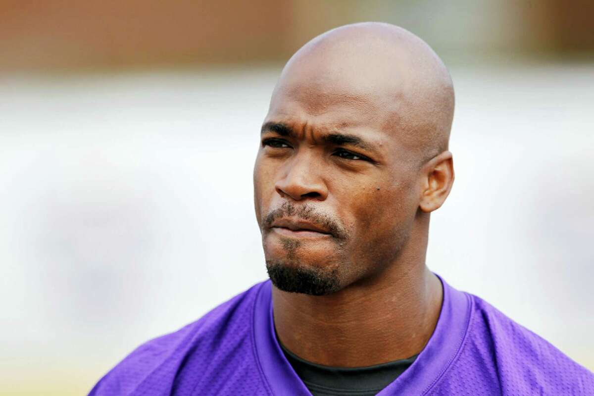 In this July 29, 2016 photo, Minnesota Vikings running back Adrian Peterson is shown during the first day of the NFL teams training camp at Mankato State University in Mankato, Minn. Peterson will undergo surgery on his right knee to repair a torn meniscus and Vikings coach Mike Zimmer says the star running back could return this season.