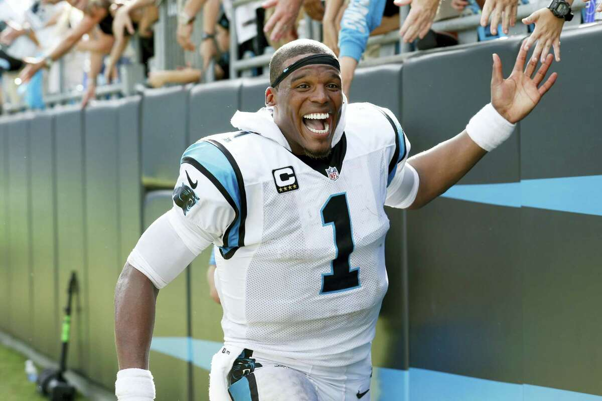 Carolina Panthers' Cam Newton (1) celebrates with fans following an NFL football game against the San Francisco 49ers in Charlotte, N.C. on Sept. 18, 2016. The Panthers won 46-27.