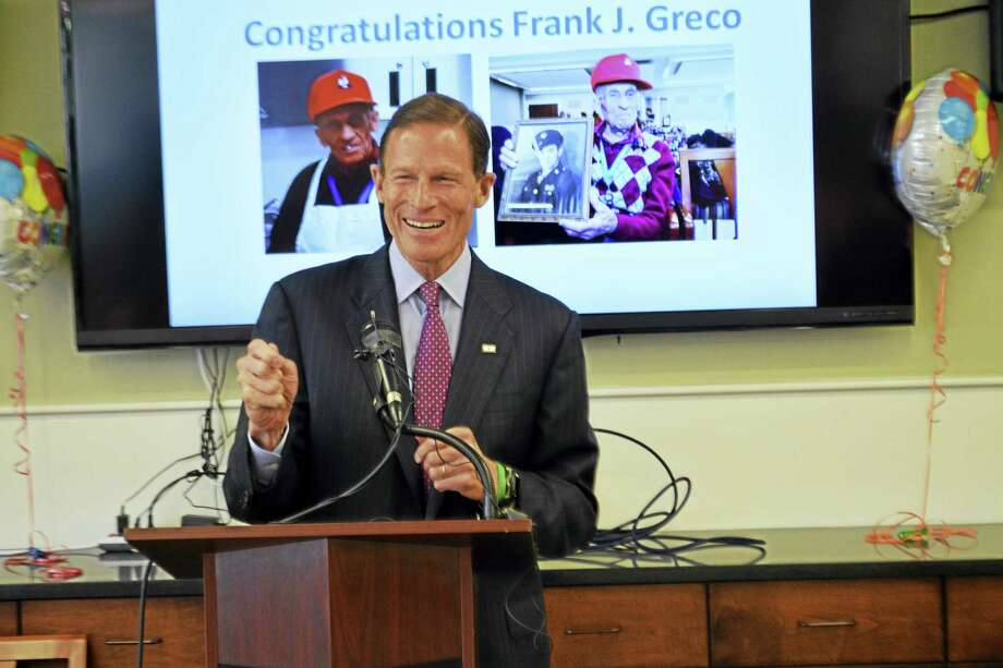 U.S. Sen. Richard Blumenthal speaks Friday during a visit to the Middletown Senior Center to congratulate WWII veteran Frank Greco on his 92nd birthday and announce a bipartisan bill that aims to reduce crimes against seniors. Photo: Cassandra Day — The Middletown Press