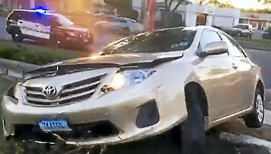 Three juveniles, including a 13-year-old from New Haven, were arrested Tuesday in Hamden after a car crashed at Hamden Plaza, 2100 Dixwell Ave. Photo: Image From Video Courtesy Of Hamden Police Department